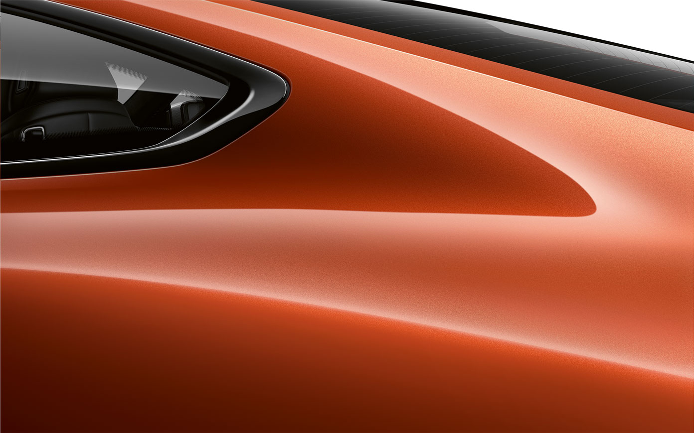 Detalle del pilar trasero del BMW Serie 8 Coupé en color Sunset Orange metalizado.